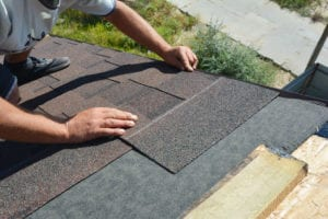 Kansas roofing weather repairs company worker